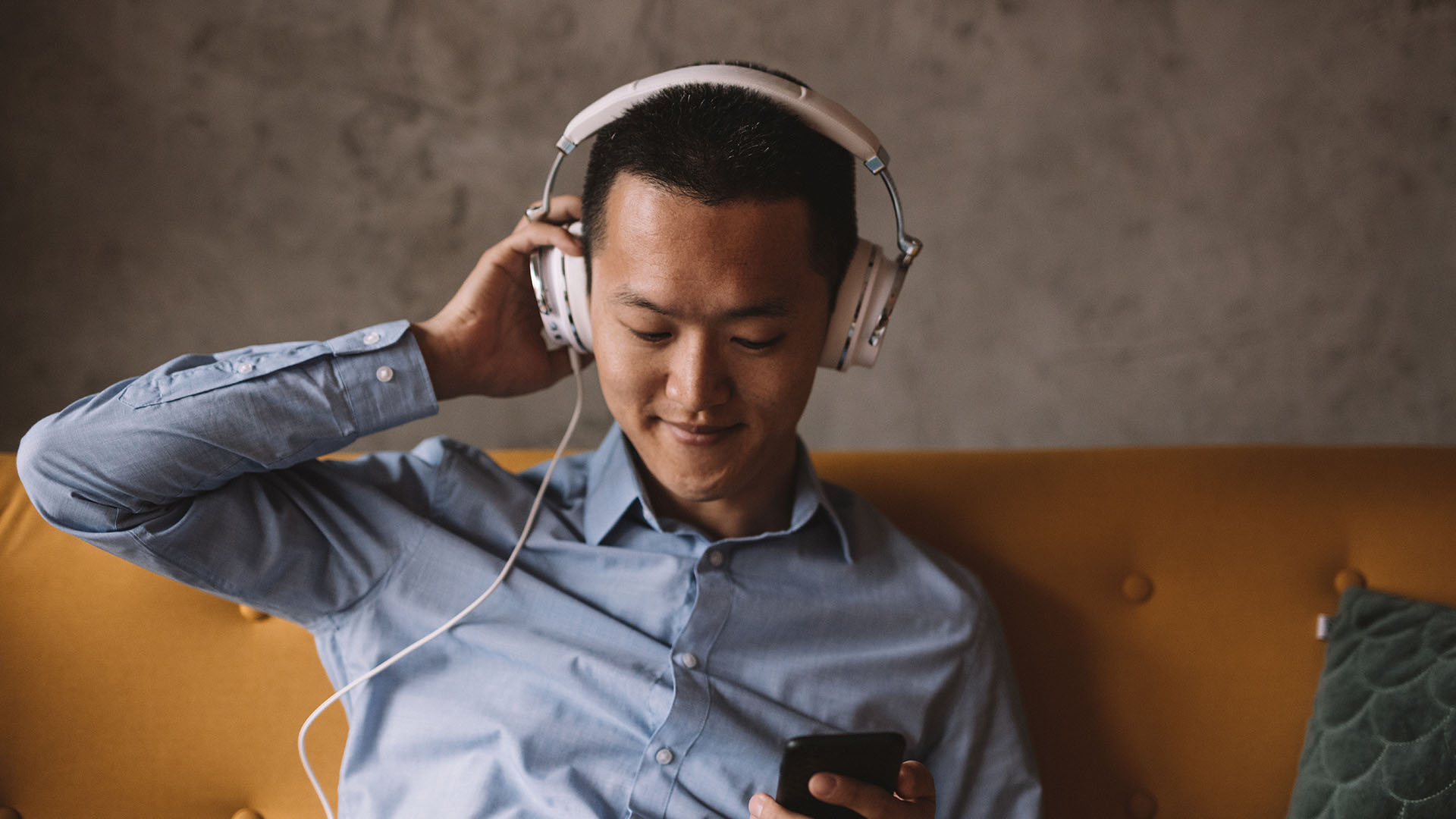 Business Owner Listening to a podcast